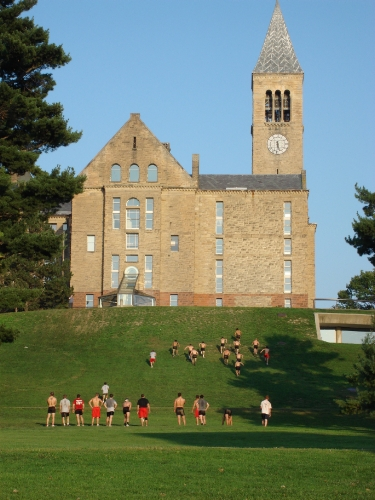 Cornell wrestlers running up a hill